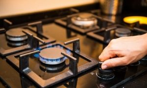 How to clean black enamel gas stove top